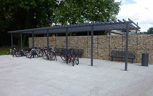 steel pergola with gabion wall